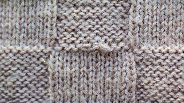Grau des strickgarns, beschaffenheitsmuster-maschenwarenahaufnahme