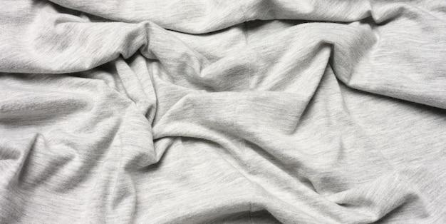 Grau melierter baumwollstoff für kleidung, stoff zerknittert, nahaufnahme