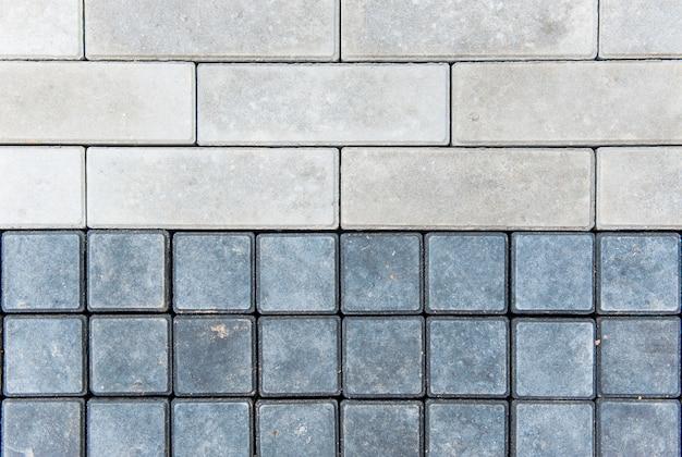 Grau-schwarze glatte reihen von pflastersteinen
