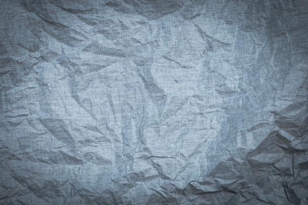 Grau zerknitterte papierbeschaffenheit für tapetenhintergrund