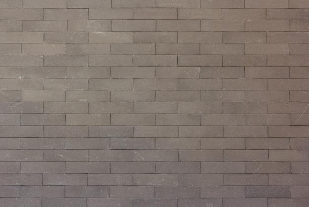 Graue backsteinmauerbeschaffenheit für hintergrund