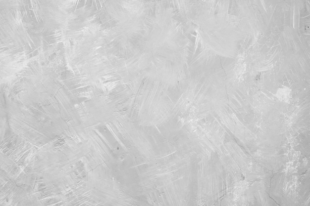 Graue betonbeschaffenheitswand mit glatter zementwand.