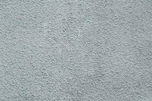 Graue betonmauer mit stuck.