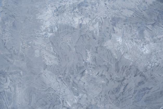 Graue betonwand mit schmutz. abstrakte wand