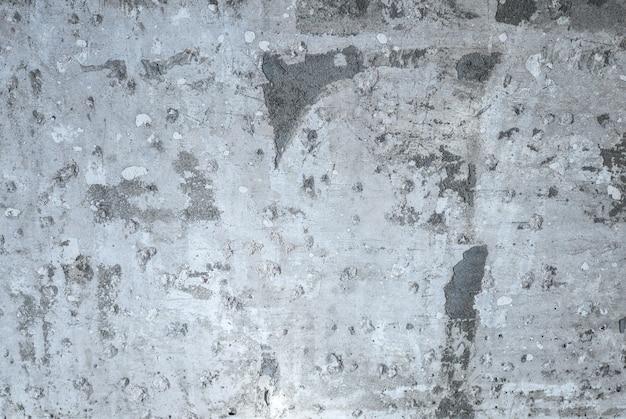 Graue betonziegel textur hintergrund. unfertiges gebäude.