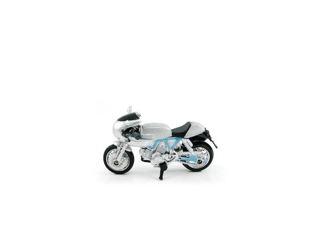 Graue farbe des motorradspielzeugs auf weißem hintergrund