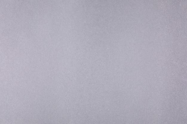 Graue leinwand mit einem zarten gitter