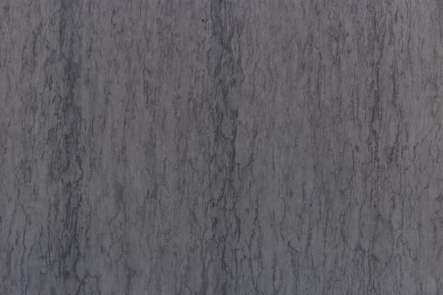 Graue marmorstruktur durchschoss mit subtilen schwarzen adern. abstrakter hintergrund.
