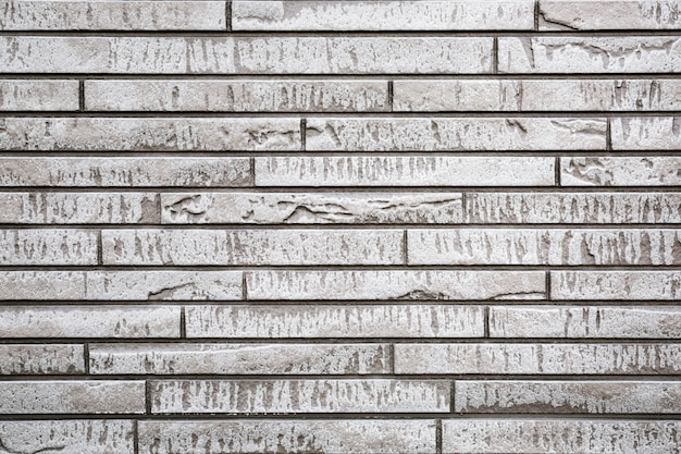 Graue moderne steinwand für gebrauch als hintergrund oder beschaffenheit.