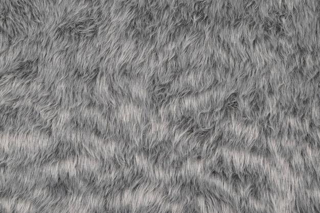 Graue pelzbeschaffenheitswand, draufsicht des pelzigen stoffmusters