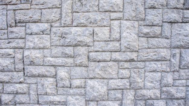 Graue steinmauerhintergrundbeschaffenheit