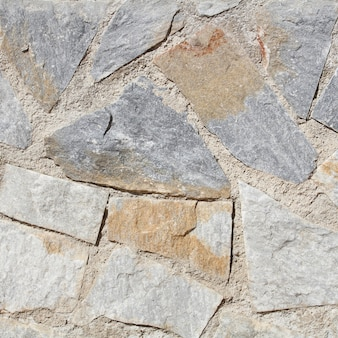Graue steinwandbeschaffenheit