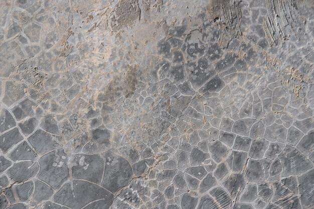 Graue strukturierte betonmauer. sichtbeton