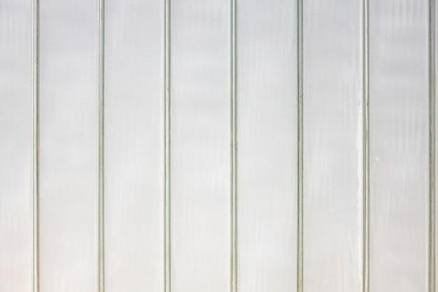 Graue strukturierte städtische metallwand für den hintergrund