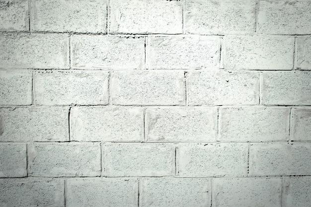 Graue stuckziegelmauer. beschaffenheit des stucks mit einem muster der ziegelsteine. grauer zementhintergrund