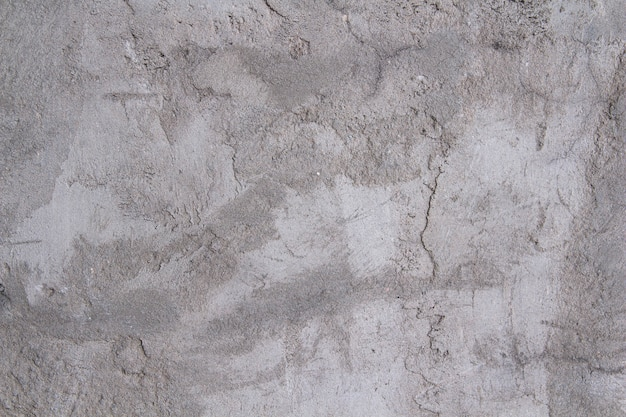 Graue textur von betonputz. raue weiß-graue wand.
