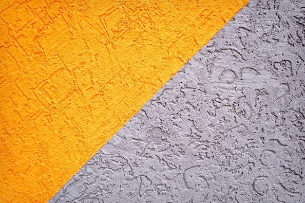 Graue und orange betonwandbeschaffenheit