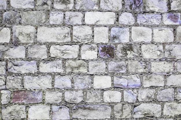 Graue und violette schmutz-backsteinmauer-hintergrundbeschaffenheit
