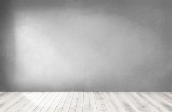 Graue Wand in einem leeren Raum mit einem Bretterboden