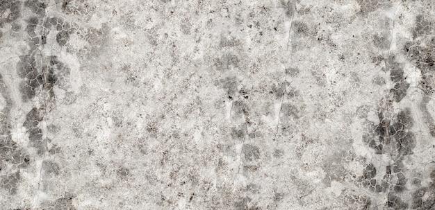 Graue zementwand oder betonoberflächenstruktur für den hintergrund.
