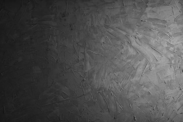 Graue zementwand und betonhintergrund