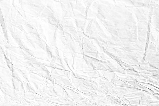 Graue zerknitterte kraftpapierhintergrundbeschaffenheit