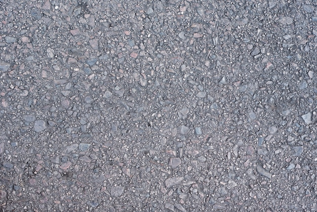 Grauer asphaltbeschaffenheitshintergrund. oberfläche der straße aus asphalt