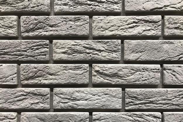 Grauer backsteinmauerbeschaffenheitshintergrund. innenarchitekturkonzept mit kopienraum