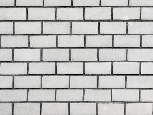 Grauer backsteinmauerbeschaffenheitshintergrund.