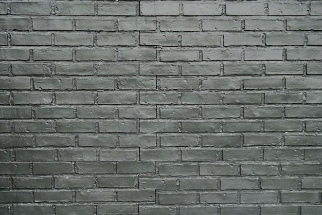 Grauer backsteinmauerbeschaffenheitshintergrund