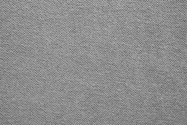 Grauer baumwollhemdgewebebeschaffenheitshintergrund