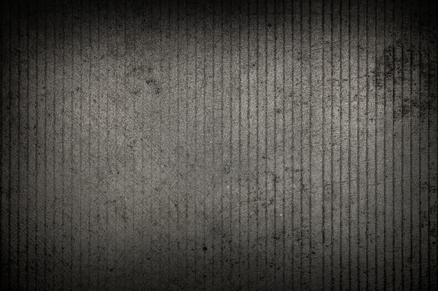 Grauer betonboden oder straßenbeschaffenheitshintergrund.