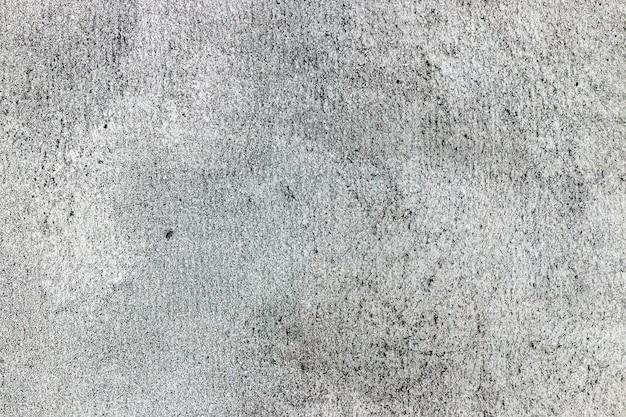 Grauer betonhintergrund mit rauer textur