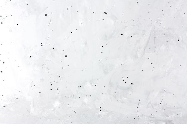 Grauer betonhintergrund mit schwarzen punkten kopieren raum