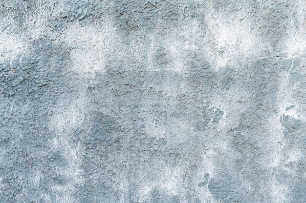 Grauer betonmauerhintergrund