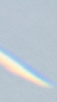 Grauer, defokussierter metallischer hintergrund mit lichtleck-handy-wallpaper