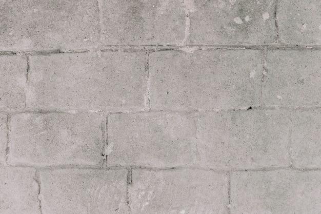 Grauer grunge backsteinmauerhintergrund