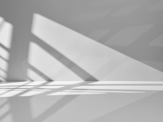 Grauer hintergrund mit lichtern und schatten für produktpräsentation