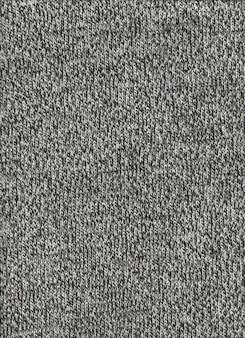 Grauer melierter wolltexturhintergrund. nahaufnahme stoff tapete