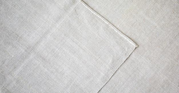 Grauer rustikaler textilleinenhintergrund. gewebe textur. ökologische moderne stofftücher.