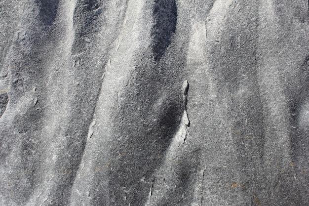 Grauer steinbeschaffenheitshintergrund. schwarzweiss-stein. granitbeschaffenheit