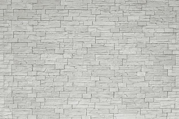 Grauer steinmosaikwandhintergrund