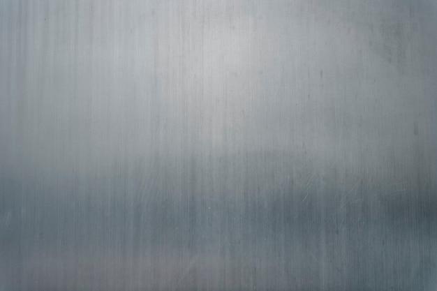 Grauer strukturierter hintergrund aus feinem metall