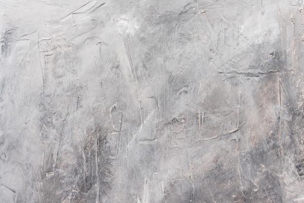 Grauer strukturierter hintergrund aus kitt erstellt.