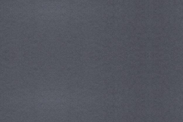 Grauer strukturierter papierhintergrund. reinigen sie strukturierten hintergrund