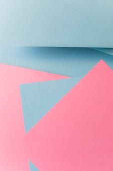 Grauer und rosa farbpapierhintergrund der abstrakten geometrischen form