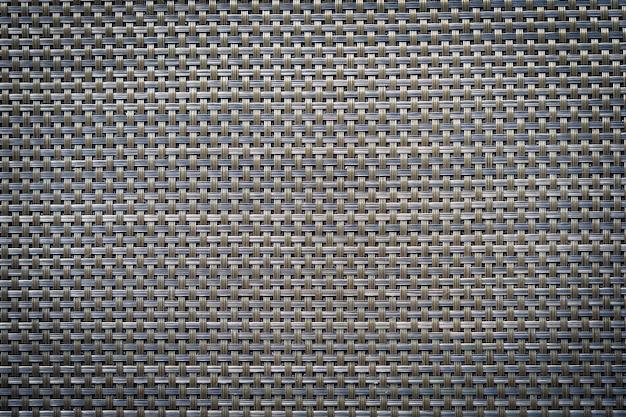 Grauer und schwarzer lederner baumwollbeschaffenheitshintergrund