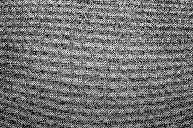 Grauer wollstoff-tweed für hintergrund. anzugstoffe