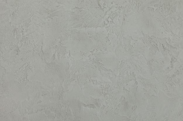 Grauer zementwand-beschaffenheitshintergrund. raue textur.