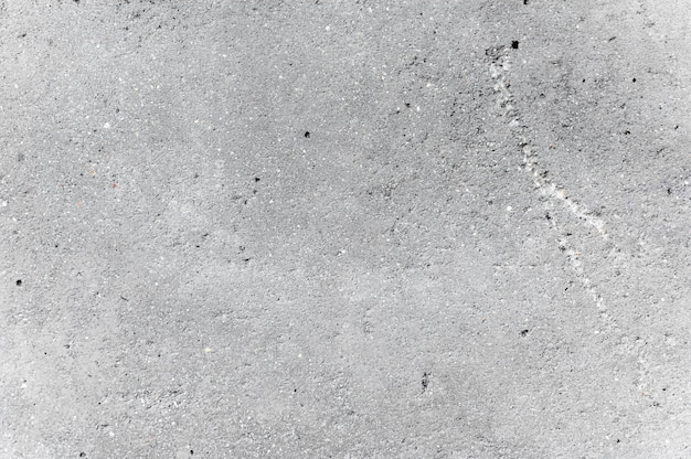Grauer zementwandhintergrund